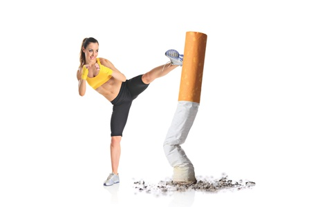 Girl kicking a cigarette butt isolated against white background photo