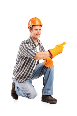 A confident and smiling worker posing isolated on white background Stock Photo - 11140576