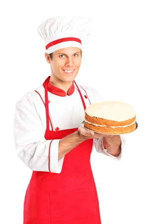 A smiling young chef holding a cake isolated on white background Stock Photo - 11140553