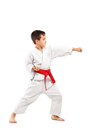 Full length portrait of a karate child posing isolated on white background photo