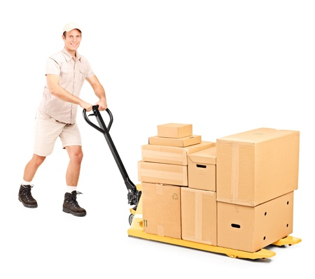 Full length portrait of a worker pushing a fork pallet truck isolated on white background photo