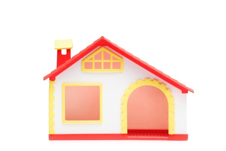 A studio shot of a miniature house isolated on white background photo