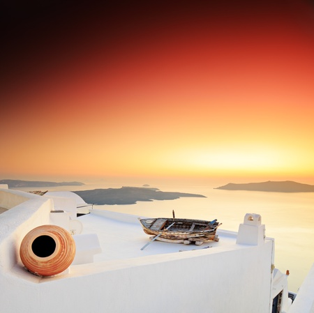 A sunset over Santorini island, Greece photo