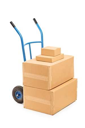 handtruck: A view of a hand truck with many boxes on it isolated on white background