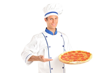 chefs show: A young chef holding a pizza isolated on white background Stock Photo