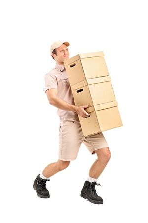 Full length portrait of a delivery person delivering boxes isolated on white background photo