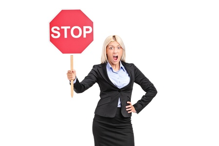 woman stop: Young businesswoman holding a traffic sign stop isolated on white background Stock Photo