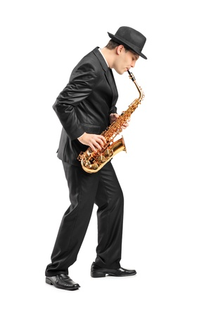 sax: Full length portrait of a young man playing on saxophone isolated on background