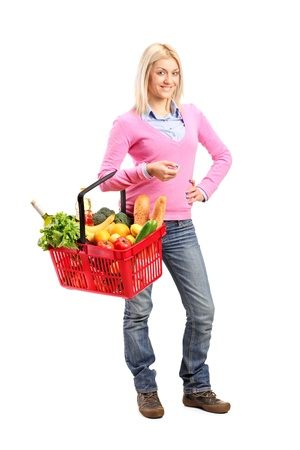 Full length portrait of a young woman holding a shopping basket isolated on white background photo
