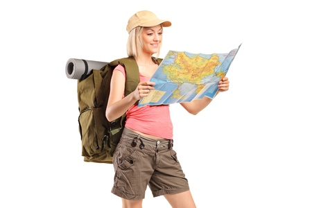trekker: Female hiker looking at map isolated on white background