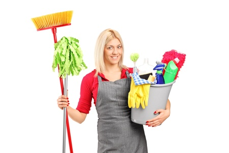 Female cleaner holding a bucket with cleaning supplies isolated on white background photo