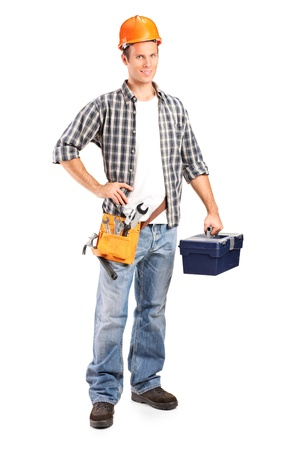 tools belt: Full length portrait of a confident and smiling manual worker holding a wrench and a toolbox isolated on white background Stock Photo
