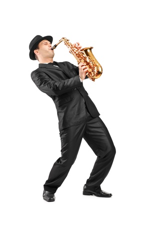 young musician: Full length portrait of a man in a suit playing on saxophone isolated on background Stock Photo