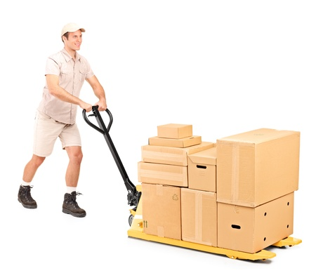Full length portrait of a manual worker pushing a fork pallet truck isolated against white background photo