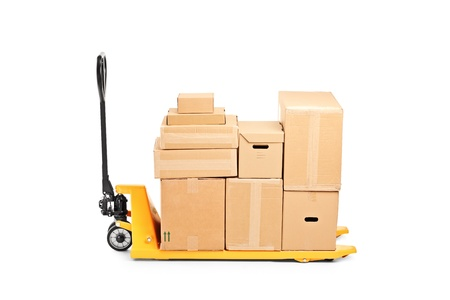 hand truck: A studio shot of a fork pallet truck stacker with many boxes isolated on white background Stock Photo