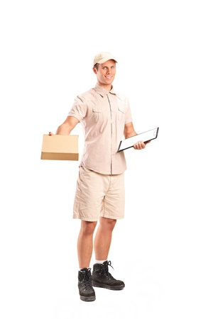 Full length portrait of a delivery boy delivering a packet and holding a clipboard isolated on white background Stock Photo - 11264748
