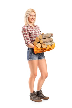 woodcutter: Full length portrait of a young craftswoman holding fire wood isolated on white background