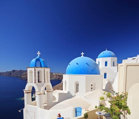 View of blue dome church in Oia village on Santorini island, Greece Stock fotó