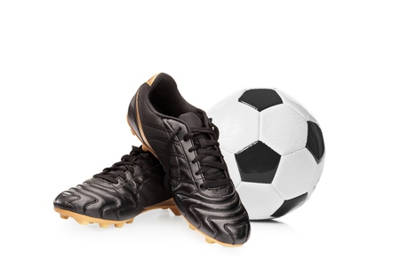 Football shoes and a football isolated on white background photo