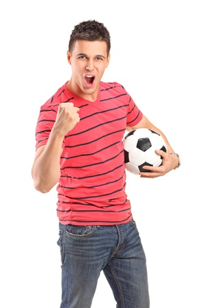 shout: Young man cheering and holding a football on white background