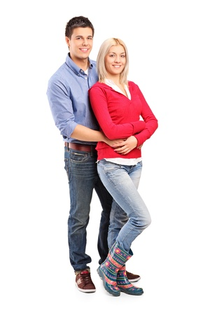 Young smiling couple in an embrace isolated against white background Stock Photo - 11409556