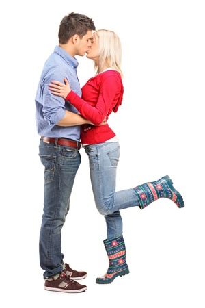 young couple hugging kissing: A view of a loving couple kissing isolated on white background