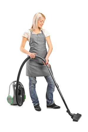 Full length portrait of a female cleaning with vacuum cleaner isolated on white background photo