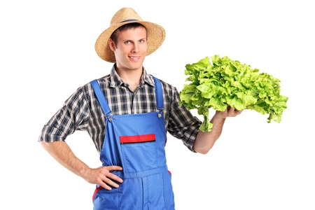 Smiling farmer holding a lettuce in his hand isolated on white background photo