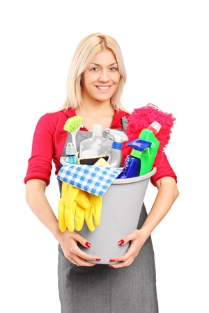 Female cleaner holding a bucket with cleaning supplies isolated on white background Stock Photo - 11409568