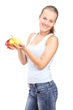 A beautiful young woman holding various fruits isolated against white background photo
