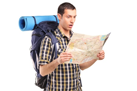 backpackers: A lost hiker looking at map isolated on white background