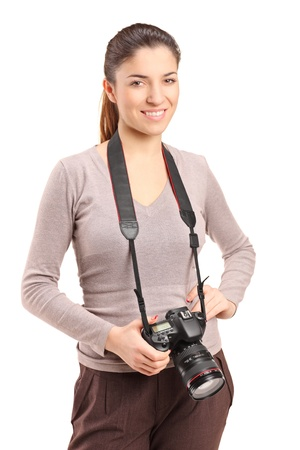 A portrait of a female photographer holding a camera isolated on white background photo