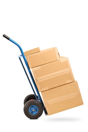 A studio shot of a hand truck with many boxes on it isolated on white background photo
