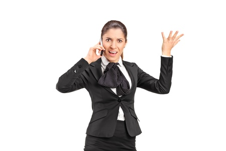 A nervous businesswoman shouting on a mobile phone isolated on white background photo