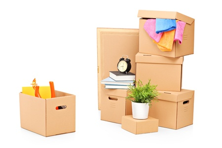 Moving boxes and other moving stuff isolated on white background photo