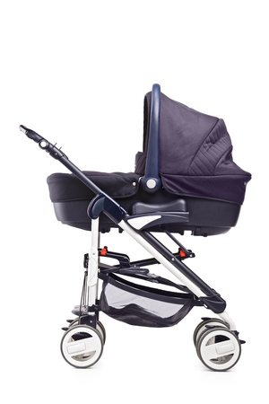 A studio shot of a baby stroller isolated against white background photo