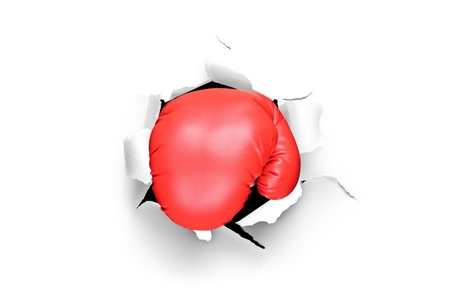 punch holes: A view of a boxing glove through a hole in paper