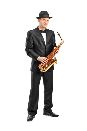 Full length portrait of a man in a suit holding a saxophone isolated on background Stock Photo - 11744364