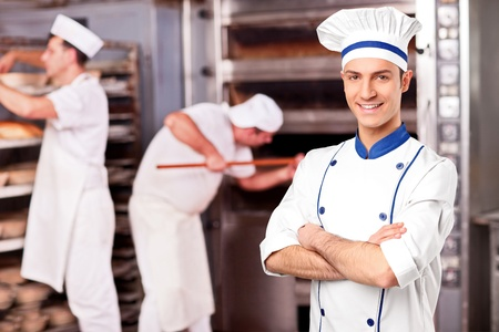 bakery oven: Portrait of a chef standing inside a bakery