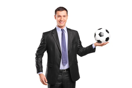 Young smiling businessman holding a football isolated on white background photo