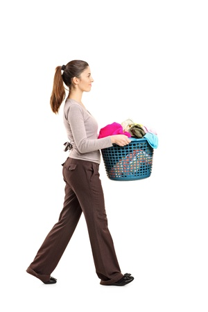 Full length portrait of a female holding a laundry basket isolated on white background photo
