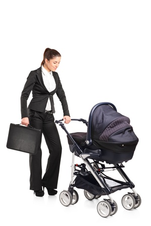 baby carriage: A young businesswoman pushing a baby stroller isolated against white background