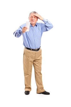 Full length portrait of a surprised senior looking at store receipt isolated on white background photo