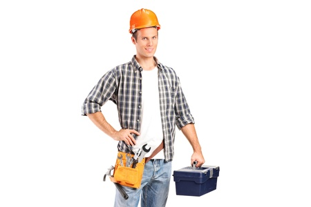 A confident and smiling manual worker holding a wrench and a toolbox isolated on white background photo
