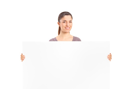 A happy woman holding a blank billboard isolated on white background photo