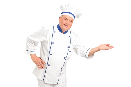 Portrait of smiling chef gesturing welcome isolated on white background photo