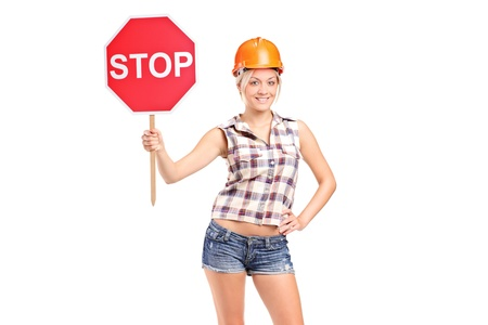 A construction worker holding a traffic sign stop isolated on white background photo