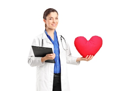 A female doctor holding a red heart isolated on white background photo
