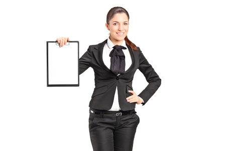 A young businesswoman holding an empty clipboard isolated on white background photo