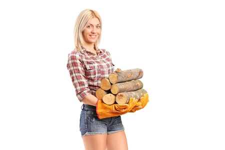 A young craftswoman holding fire wood isolated on white background photo